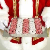 Rondlopende Kerstman met Kerstkransjes
