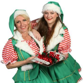2 Kerstvrouwtjes delen kerstkransjes uit inhuren of boeken?