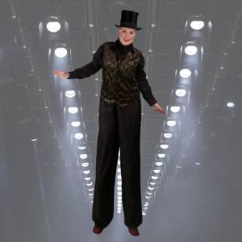 2 Steltlopers - Chique in Zwart Kostuum Boeken of Inhuren?