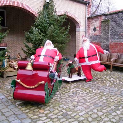 Kerstmannen met hun Arrenslee