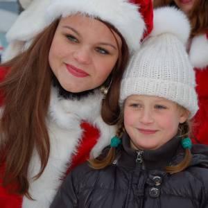 De Kerstman en het Kerstvrouwtje delen Kerstkransjes uit boeken of inhuren?