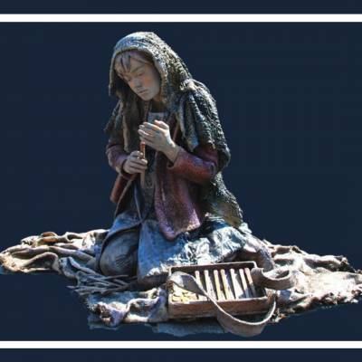 Foto van Het Meisje met de Zwavelstokjes - Levend Standbeeld | SintenKerst