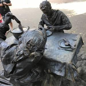 Wat schaft de pot levend standbeeld